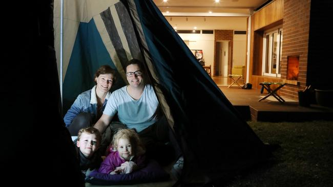 Jaclyn and Ben Derrin camping out in their backyard with their kids Leo and Arwen. Picture: Brianne Makin