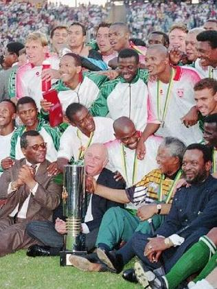 Mandela celebrates with the victorious Bafana Bafana soccer team at the 1996 African Cup of Nations.
