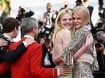 "Elle Fanning and Nicole Kidman depart after the ""How To Talk To Girls At Parties"" screening during the 70th annual Cannes Film Festival at Palais des Festivals on May 21, 2017 in Cannes, France. Picture: Getty"