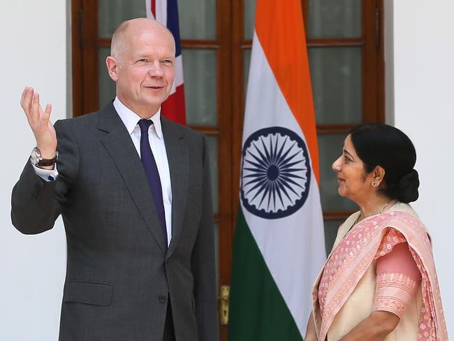 British Foreign Secretary William Hague speaks with Indian Foreign Minister Sushma Swaraj this month. AP Photo /Manish Swarup