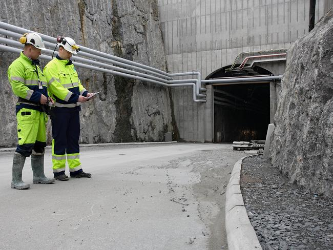 Workers stand outside the Onkalo Nuclear waste storage in Finland. Picture: Posiva Oy