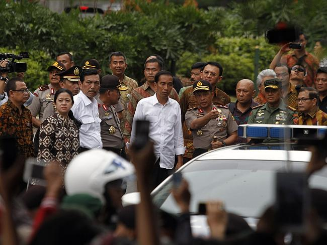 Aftermath ... Indonesian President Joko Widodo visits the scene of a bomb blast in Jakart
