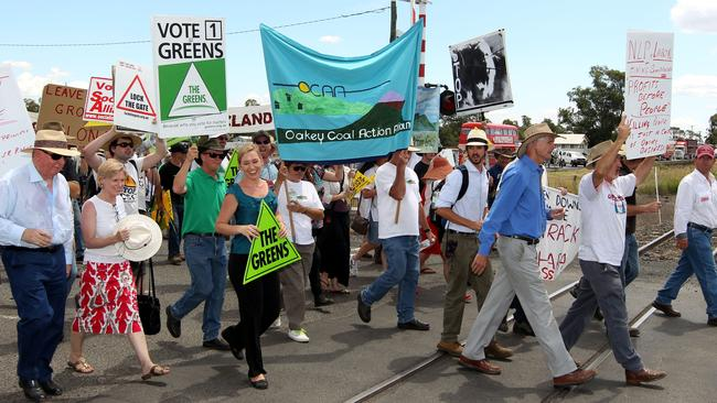 Whaaat? Yep, that's Jones, left in blue, marching alongside Qld greens Senator Larissa Water in (you guessed it) green.