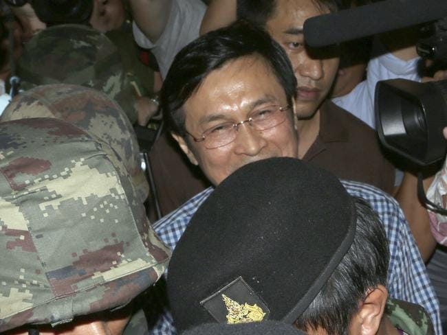 Press gang ... Former Thai Education Minister Chaturon Chaisang, centre, after being detained by soldiers following a news conference at the Foreign Correspondents' Club of Thailand in Bangkok, Thailand. Picture: Apichart Weerawong