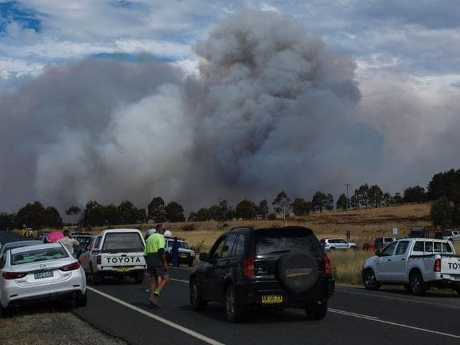 Motorists at a road block near Queanbeyan view the devastation.