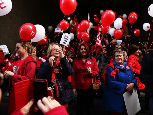Teachers take to the streets to protest against any reduction in conditions. Picture: Brett Costello