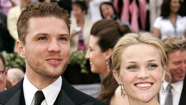 Ryan Phillippe arrives with his now ex-wife Reese Witherspoon at the Academy Awards in 20