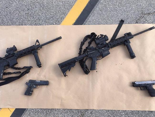 Ready for war ... weapons carried by the couple in the mass shooting during a holiday party at the Inland Regional Center, which provides services for people with disabilities. Picture: AFP/San Bernardino County Sheriff
