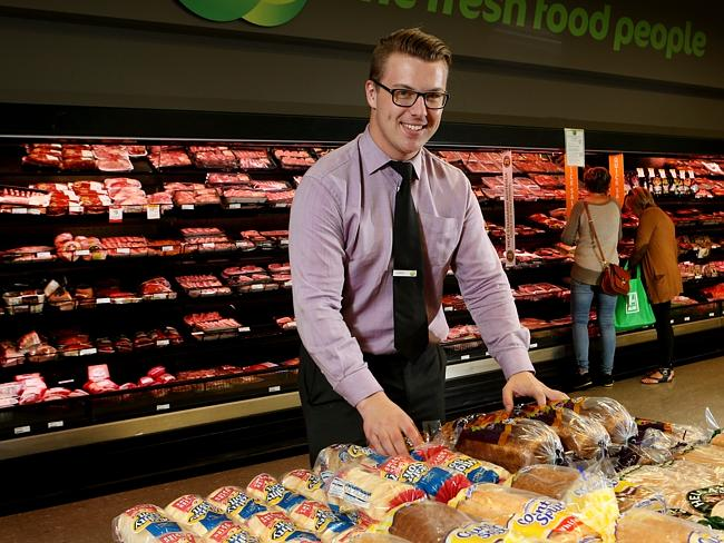 First found work at age 17 ... Chris Saunders is now a store manager at Woolworths in Coburg. Picture: Ian Currie.