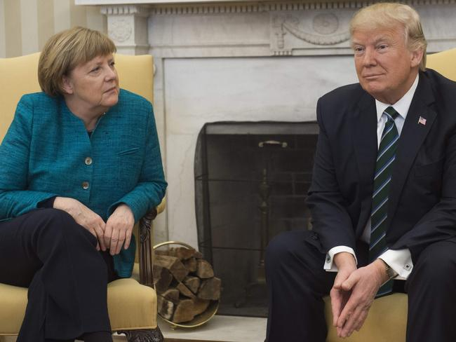 Things got awkward real quick between Angela Merkel and Donald Trump. Picture: AFP/Saul Loeb