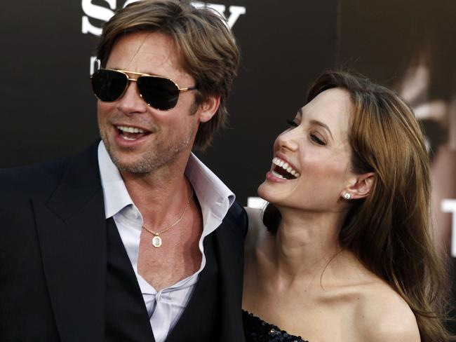 Hollywood's perfect couple ... Angelina Jolie and Brad Pitt arrive at the premiere of Salt.