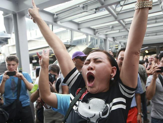 Brave few... A protester shouts during an anti-coup demonstration at an overpass in Bangkok. Picture: Wason Wanichakorn