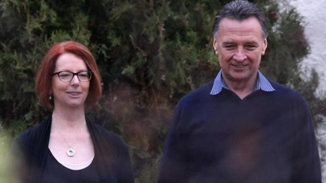 Julia Gillard walks with former colleague and friend Craig Emerson at The Lodge before moving out. Picture: Gary Ramage