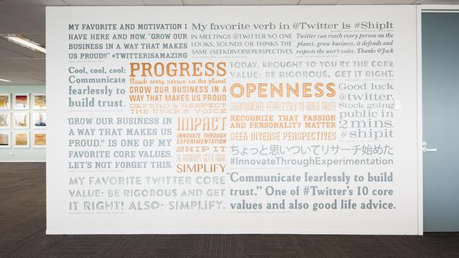 In every Twitter office there is the mantra of the company written on the wall. This one was hand painted by a Sydney artist.