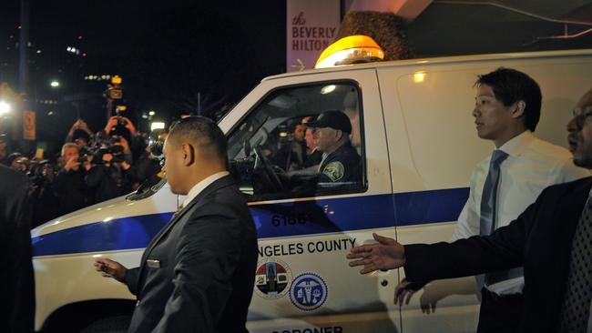 A coroner's van carrying the body of Whitney Houston leaves the Beverly Hilton Hotel.