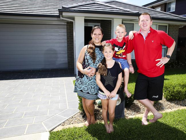 Gareth and Nicole Timbs at their airconditioned home with their children Alissa and Jake. Picture: News Corp