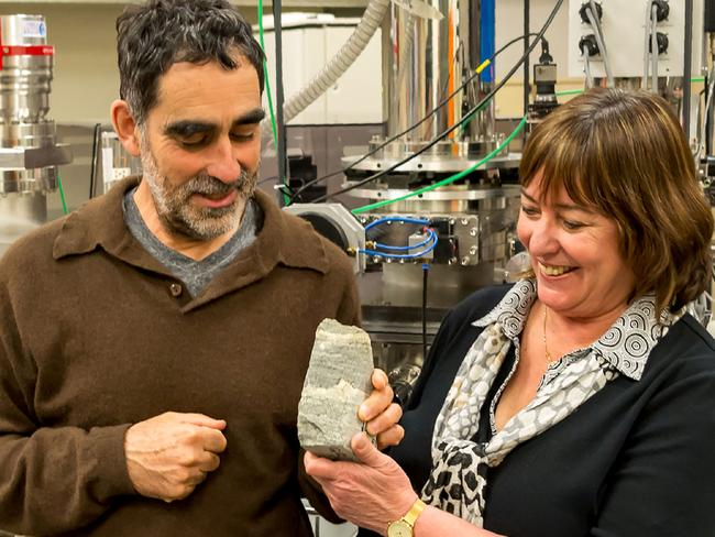 Professor Allen Nutman and associate professor Vickie Bennett with a rock specimen containing 3.7-billion-year-old stromatolites from the Isua SupercrustalBelt in southwest Greenland. Picture: University of Wollongong