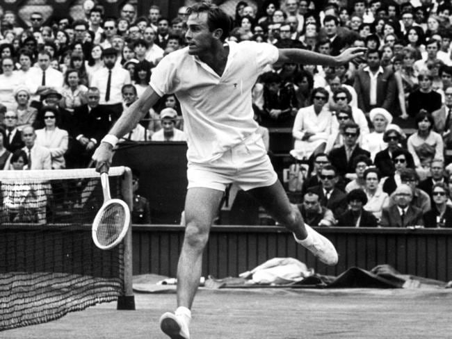 John Newcombe returns the ball in the 1967 semi-final at Wimbledon.