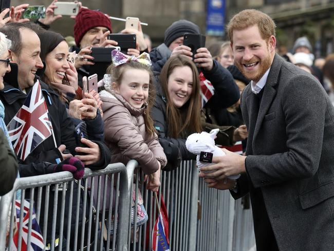 Prince Harry meets the people. Picture: Andrew Milligan/Pool Photo via AP