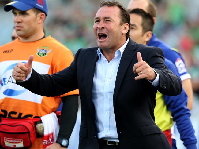 Coach Ricky Stuart celebrates after his side beat the Cowboys.