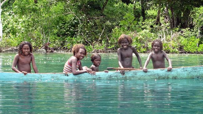 Solomon Islands, children in a canoe somewhere off Gizo.