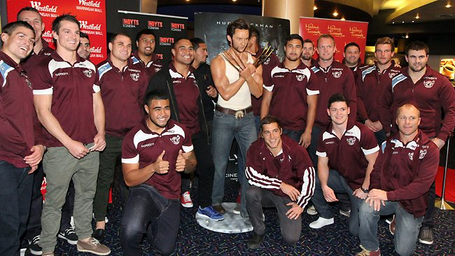 Sea Eagles squad mingling with a wax version of Manly diehard Hugh Jackman.