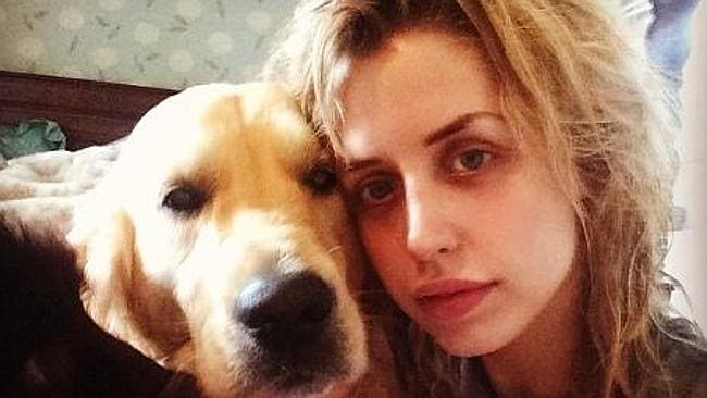 """""""Stealing a kiss"""" ... Peaches Geldof, a prolific social media user, shared this picture of her with her dog on Instagram. Picture: Instagram"""