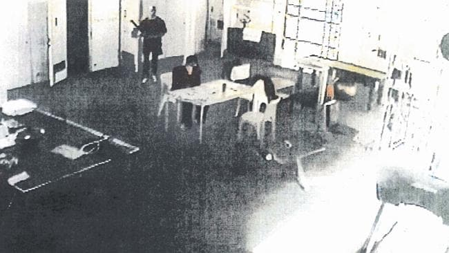 CCTV footage shows Matthew Johnson standing behind Carl Williams moments before the killing.