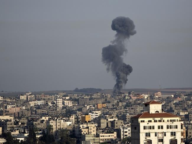 Concerns over civilians ... smoke billows following an Israeli air strike in Gaza City on July 12, 2014. Picture: Mahmud Hams