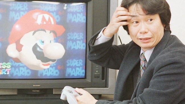 Shigeru Miyamoto, the creator of Super Mario, shows off Super Mario 64, in 1997. Picture: AP