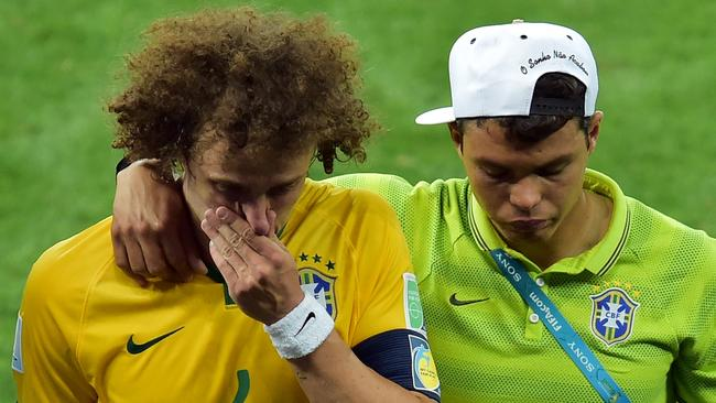 Brazil's defender David Luiz (R) is consoled by Brazil's defender and captain Thiago Silva.