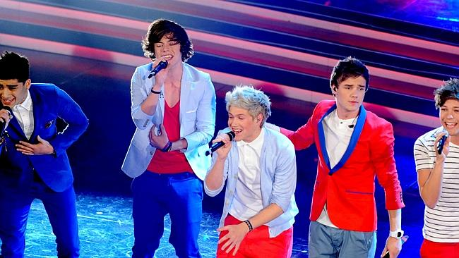 Singing sensation ... British-Irish boy-band One Direction is making a killing.