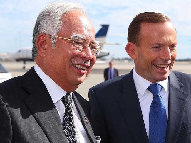 Optimistic ... Australian Prime Minister Tony Abbott (R) bids farewell to Malaysian Prime Minister Najib Razak after his visit to Perth.