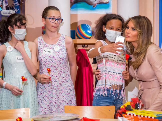 US First Lady Melania Trump, right, poses for a selfie as she visits the Queen Fabiola children's hospital, on the sidelines of the NATO summit in Brussels. Picture: AFP / Aurore Belot