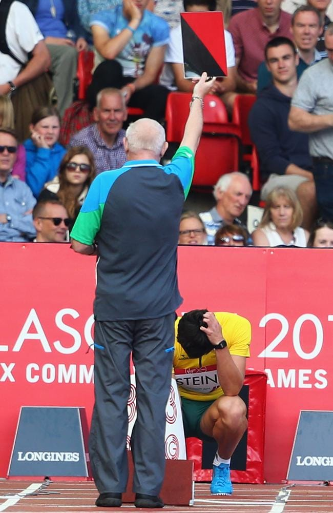 Australia's Jake Stein holds his head in his hands after being disqualified from the decathlon 100m after two false starts.