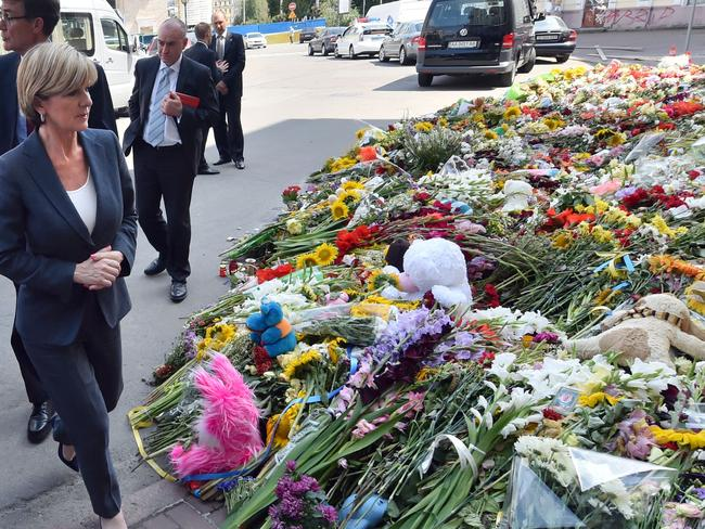 Moving tribute ... Foreign Minister Julie Bishop walks past flowers laid in memory of the victims of downed Malaysia Airlines flight MH17 in front of the Netherlands' embassy in Kiev. Picture: AFP
