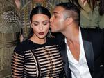 Balmain designer Olivier Rousteing kisses Kim Kardashian as they pose prior to attending the 'Vogue Paris Foundation' party in Paris. Picture: AP