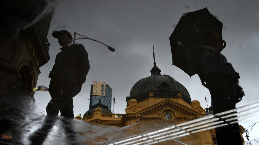 Pack your umbrella Melbourne. It's a very grey and wet morning. Picture: Nicole Garmston