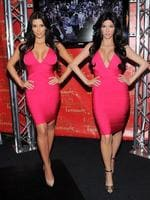 <p>Spot the difference... Kim Kardashian poses with her wax figure replica at Madame Tussauds New York. Picture: AP / Evan Agostini</p>