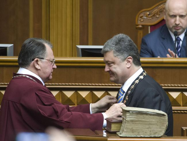 'Step in the right direction' ... Petro Poroshenko takes the oath of office as Ukraine's president, calling on armed groups to lay down their weapons. Picture: Anastasia Sirotkina