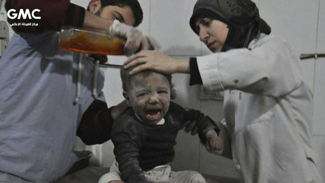 Medics treat a child who was wounded during air strikes and shelling by Syrian government forces, at a makeshift hospital in Ghouta. Picture: Ghouta Media Center/AP