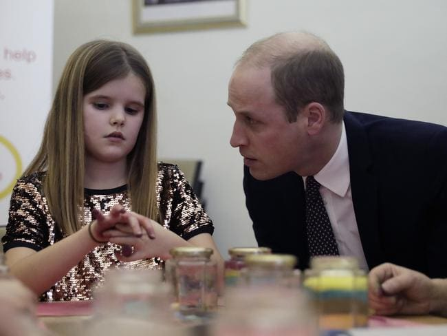 Prince William consoles nine-year-old Aoife during his visit to a Child Bereavement Centre in Stratford in East London. Picture: Matt Dunham.