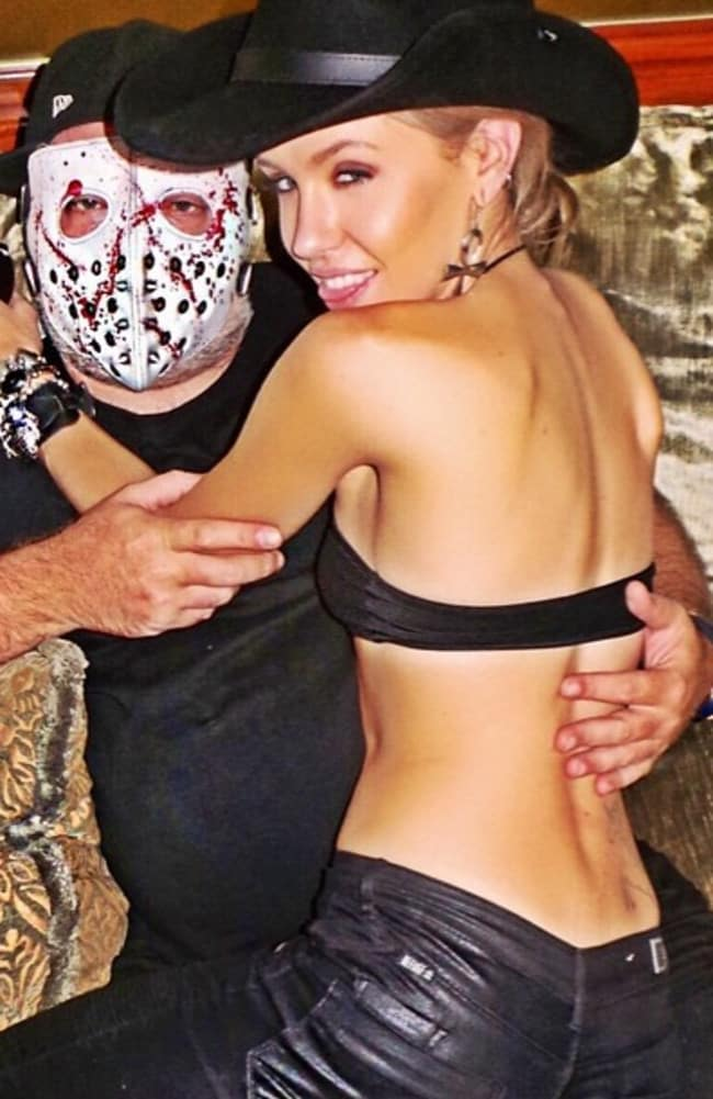 Imogen Anthony straddles a mask wearing Kyle Sandilands.