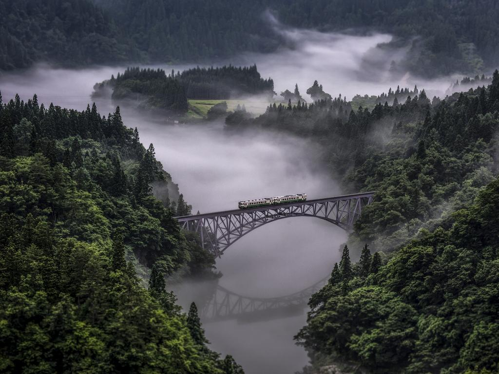 Photo by TERUO ARAYA / National Geographic Nature Photographer of the Year contest Tadami Line Tadami line is a JR East line that connects Fukushima pref and Niigata pref. It is a single-track, non-electrified local line. This line runs through the serene countryside where people live closely to the nature in satoyama, the border area between mountain foothills and flat land. Especially along the Tadami River, the view from the train is stunning. The train goes over a number of bridges passing cherry blossoms in spring, greenery in summer, colored leaves in autumn, and snow in winter.