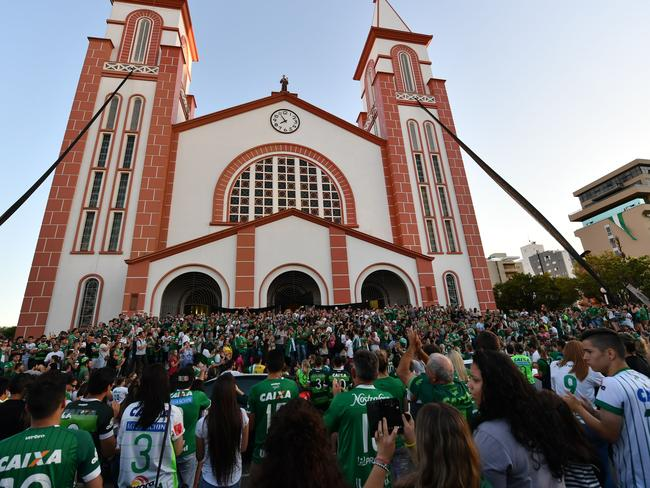 People surround a church during a mass in memoriam of the players of Brazilian team Chapecoense Real.