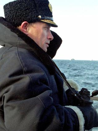 Putin looks out of a nuclear submarine Karelia, in the Barents Sea, in Severomorsk, in 2000.