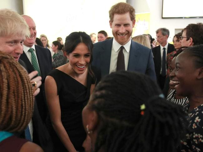 Britain's Foreign Secretary Boris Johnson (left), Prince Harry and his fiance Meghan Markle speak with guests. Picture: Getty Images/Chris Jackson