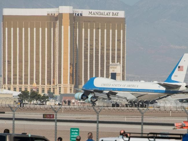 Air Force One lands at McCarran International Airport in Las Vegas, with the Mandalay Bay resort in the background.