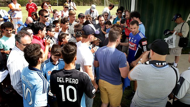 Fans mob Alessandro Del Piero for an autograph and photo after Sydney FC training. Picture: Gregg Porteous