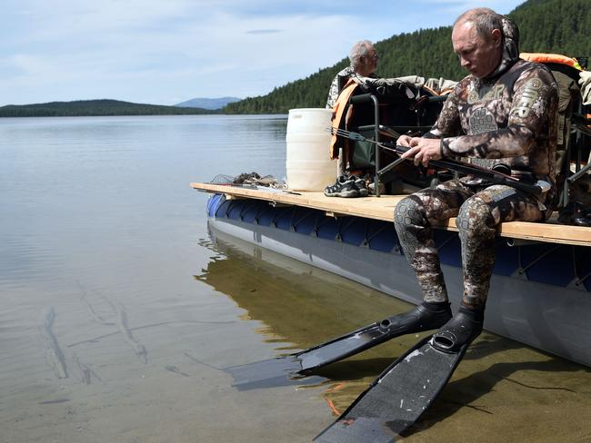 Vladimir gets set for a dive while on holiday in Siberia. Picture: AP/Sputnick/Alexey Nikolsky
